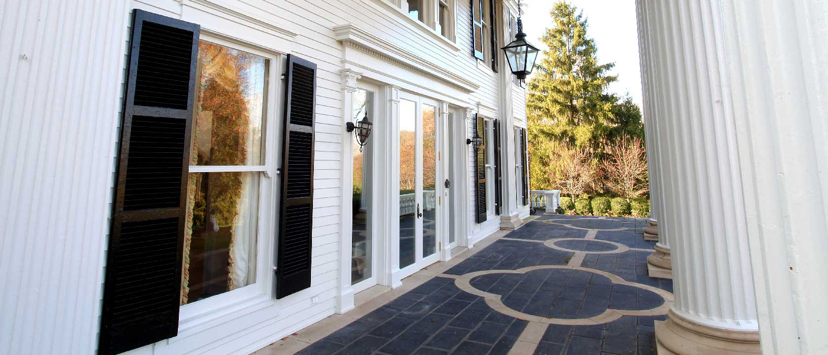porch view example Steilberg residential exterior painting - white greek revival house