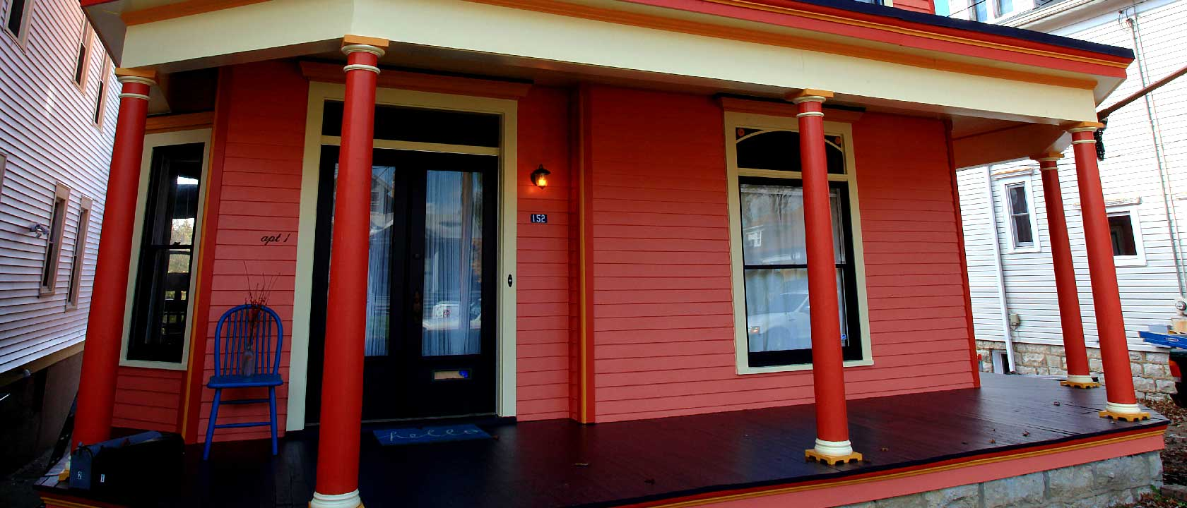 exterior paint job of red historic Princess Ann style home in the Clifton area.